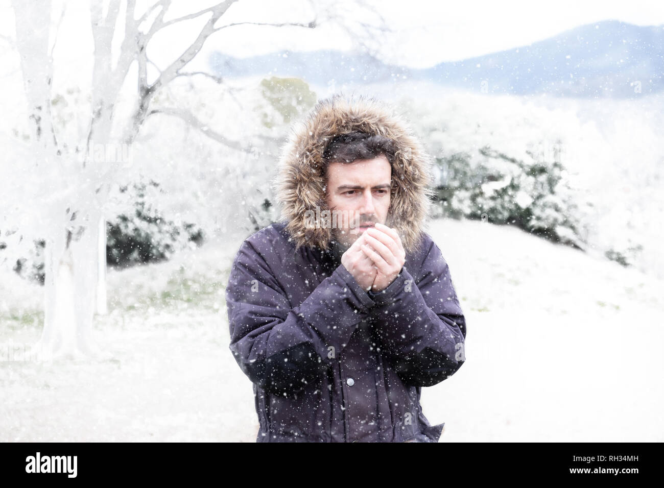 Man in winter season and snowy day - Stock Image