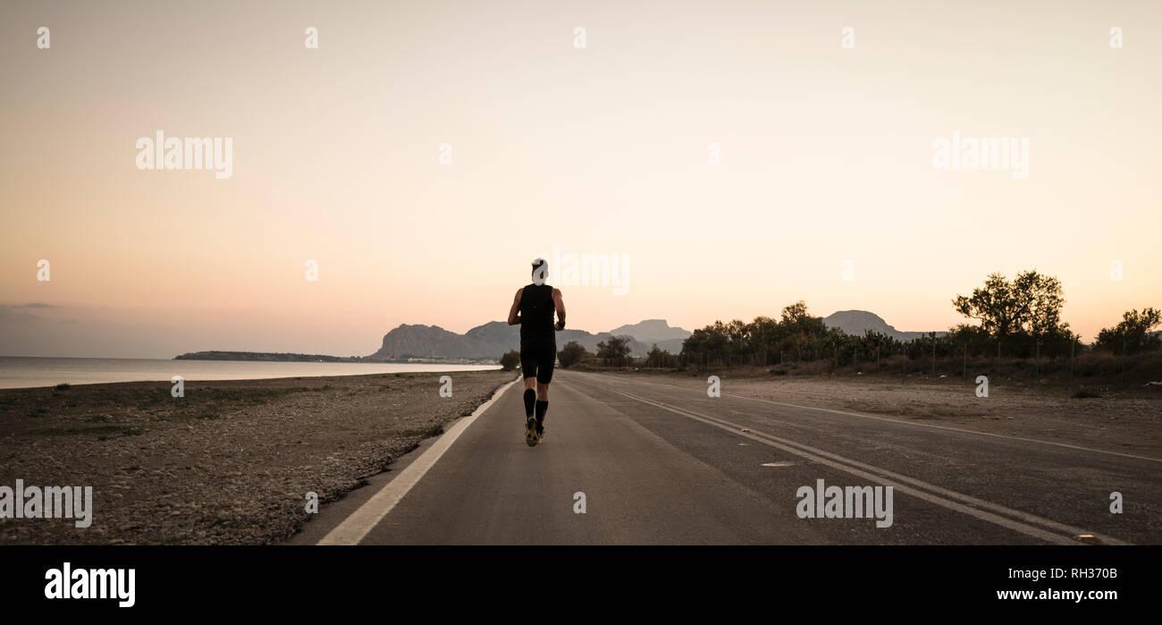 man running at sea - Stock Image