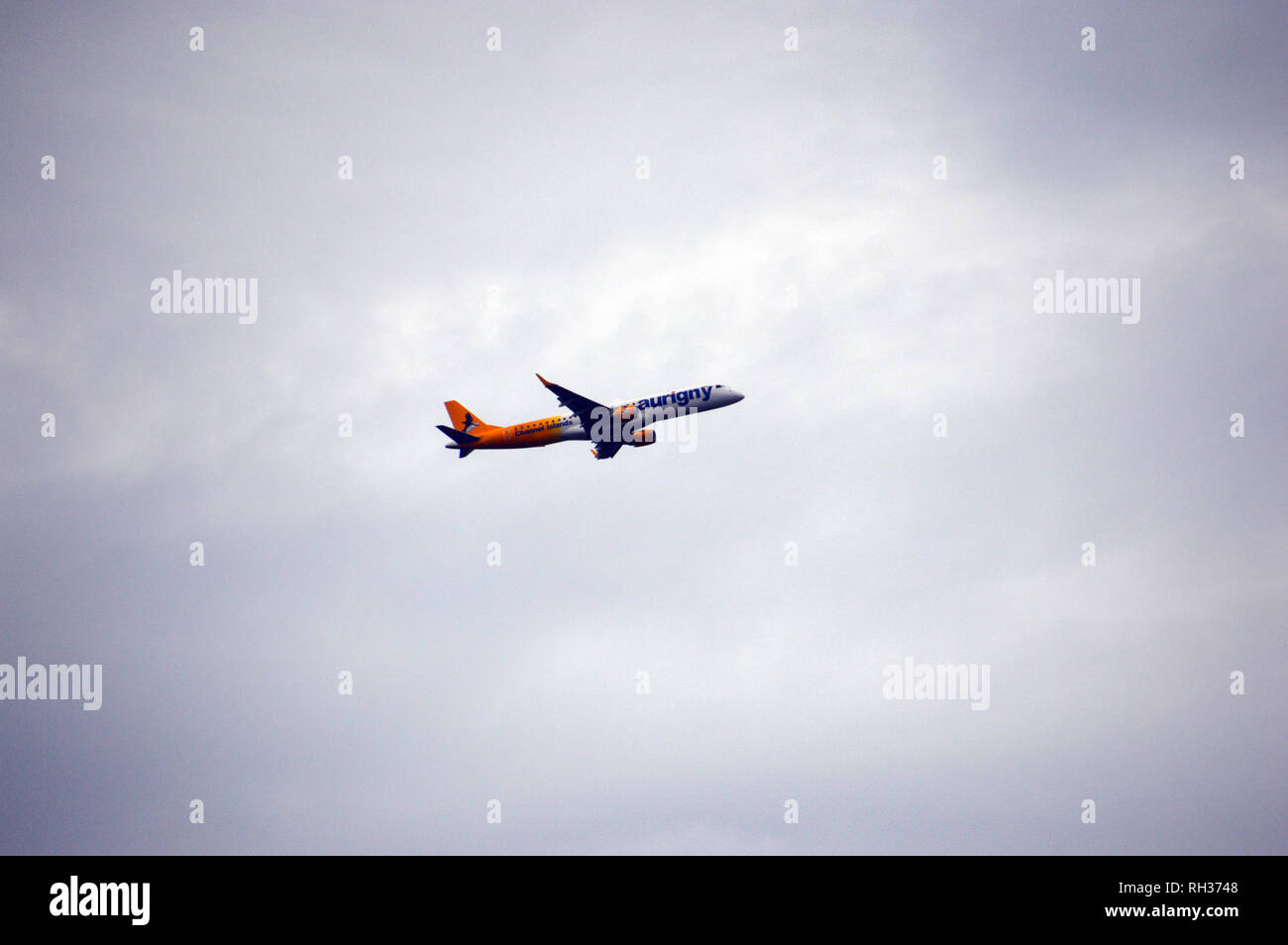A Embraer 195 Twin Jet Engine Aurigny Plane Taking Off from the Airport on Guernsey, Channel Islands.UK. - Stock Image