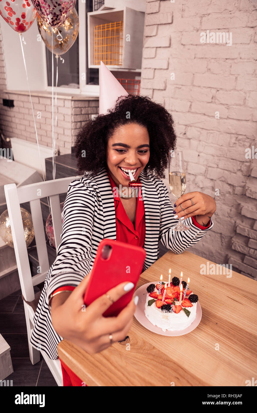 Nice cheerful woman posing for a photo - Stock Image