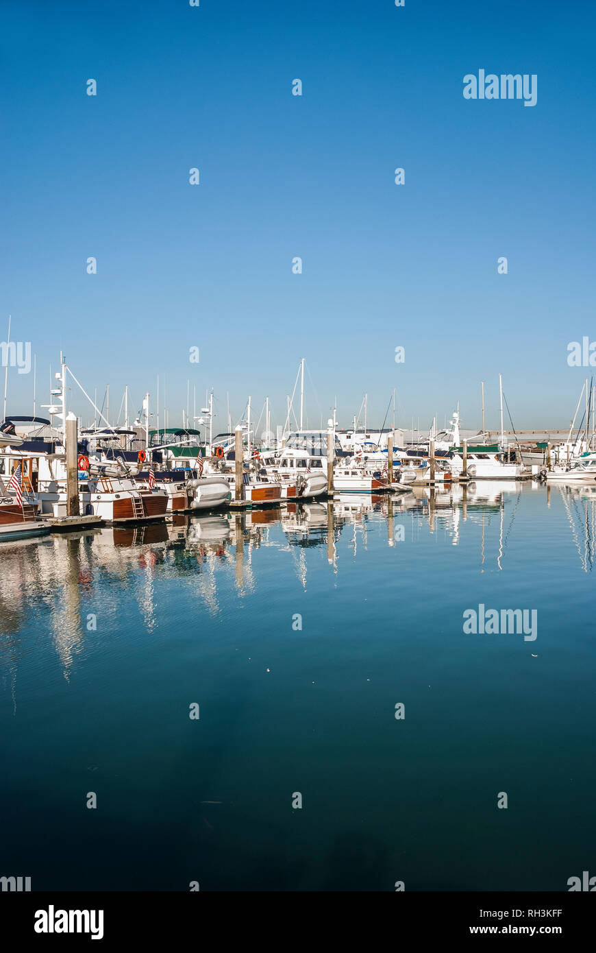 Boats are in a line at a marina in Bellingham, Washington. - Stock Image
