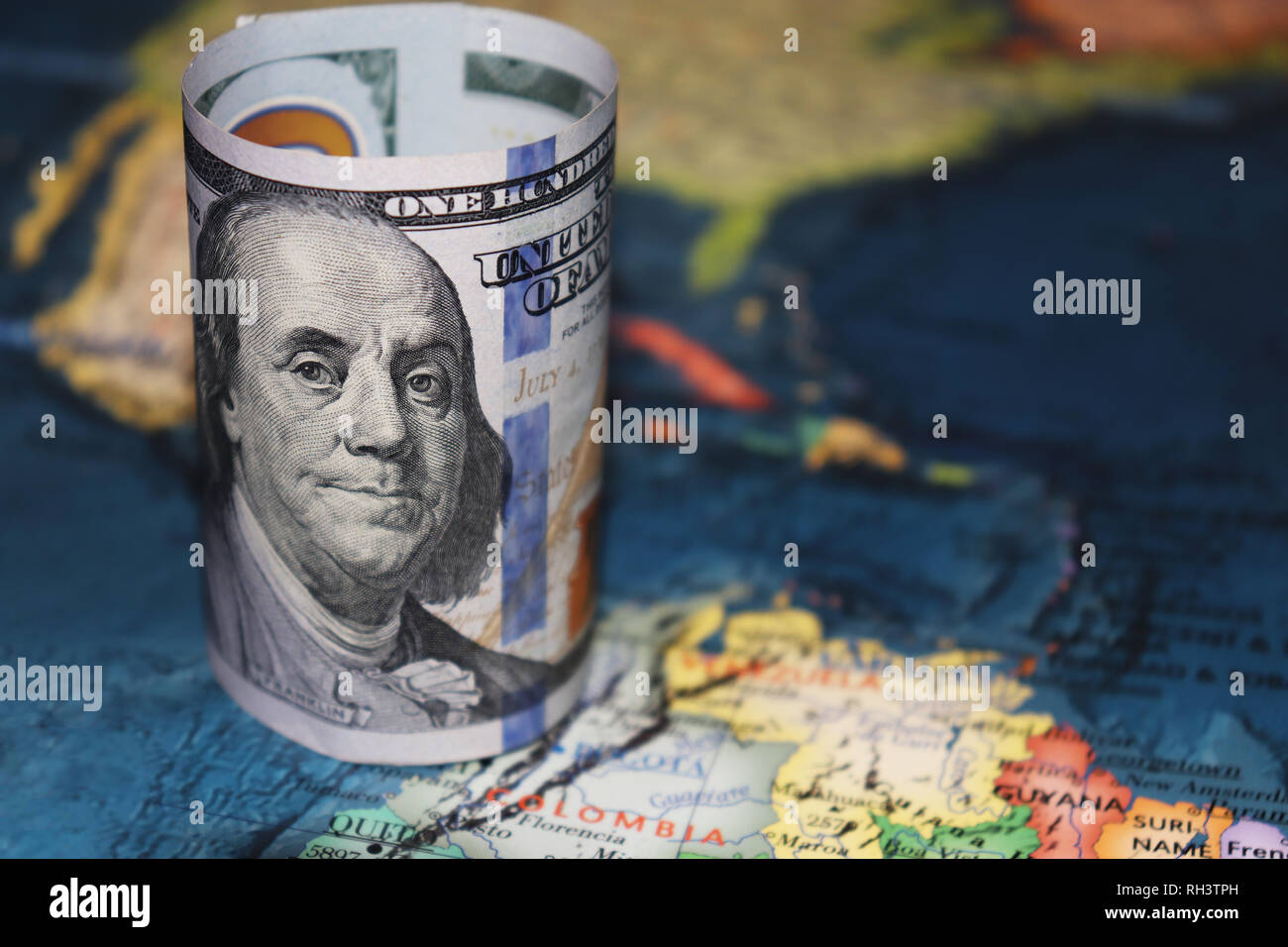 US dollar on the map of Latin America. Concept of political crisis in Venezuela, american influence - Stock Image