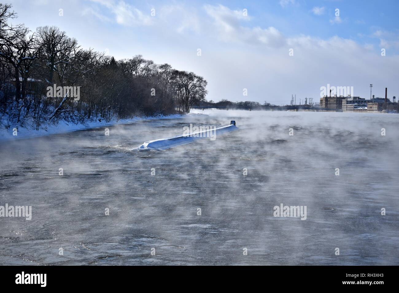 water vapor fog coming of the river on a cold day - Stock Image