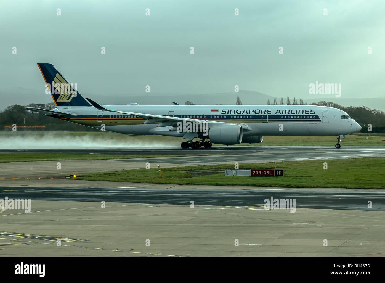 A Singapore Airlines Airbus A350, registered 9V-SMS, landing at Manchester Airport in England. - Stock Image