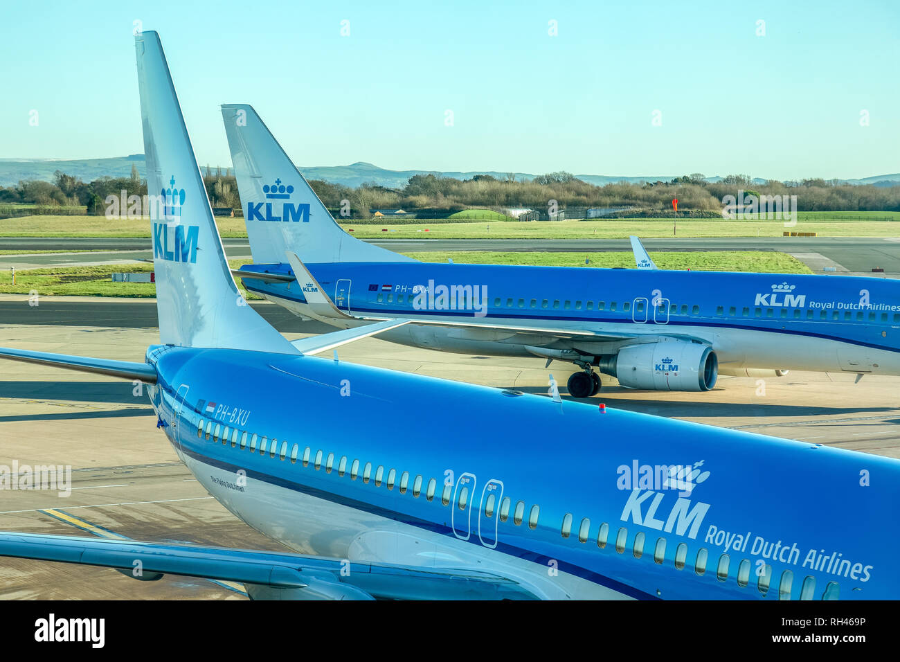 Two KLM Boeing 737-800 aircraft at manchester Airport in England. - Stock Image