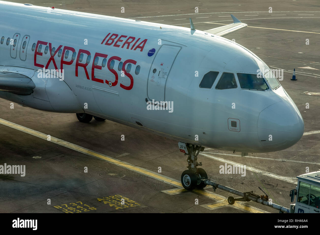 An Iberia Express Airbus A320, registered as EC-JFH, at manchester Airport in England. - Stock Image