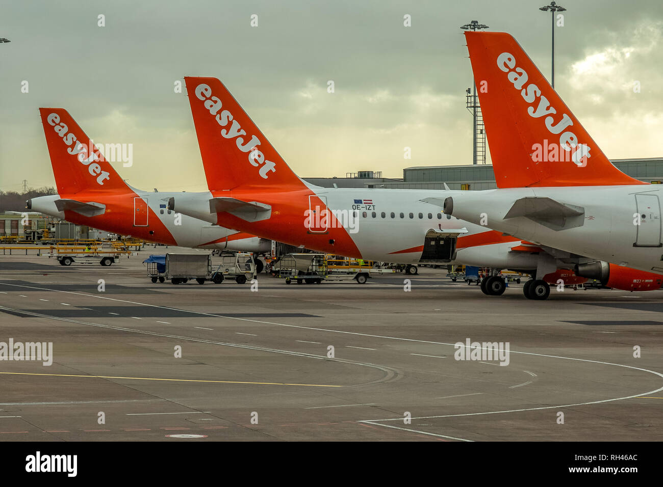 Three Easyjet Airbus aeroplanes at Manchester Airport in England. - Stock Image