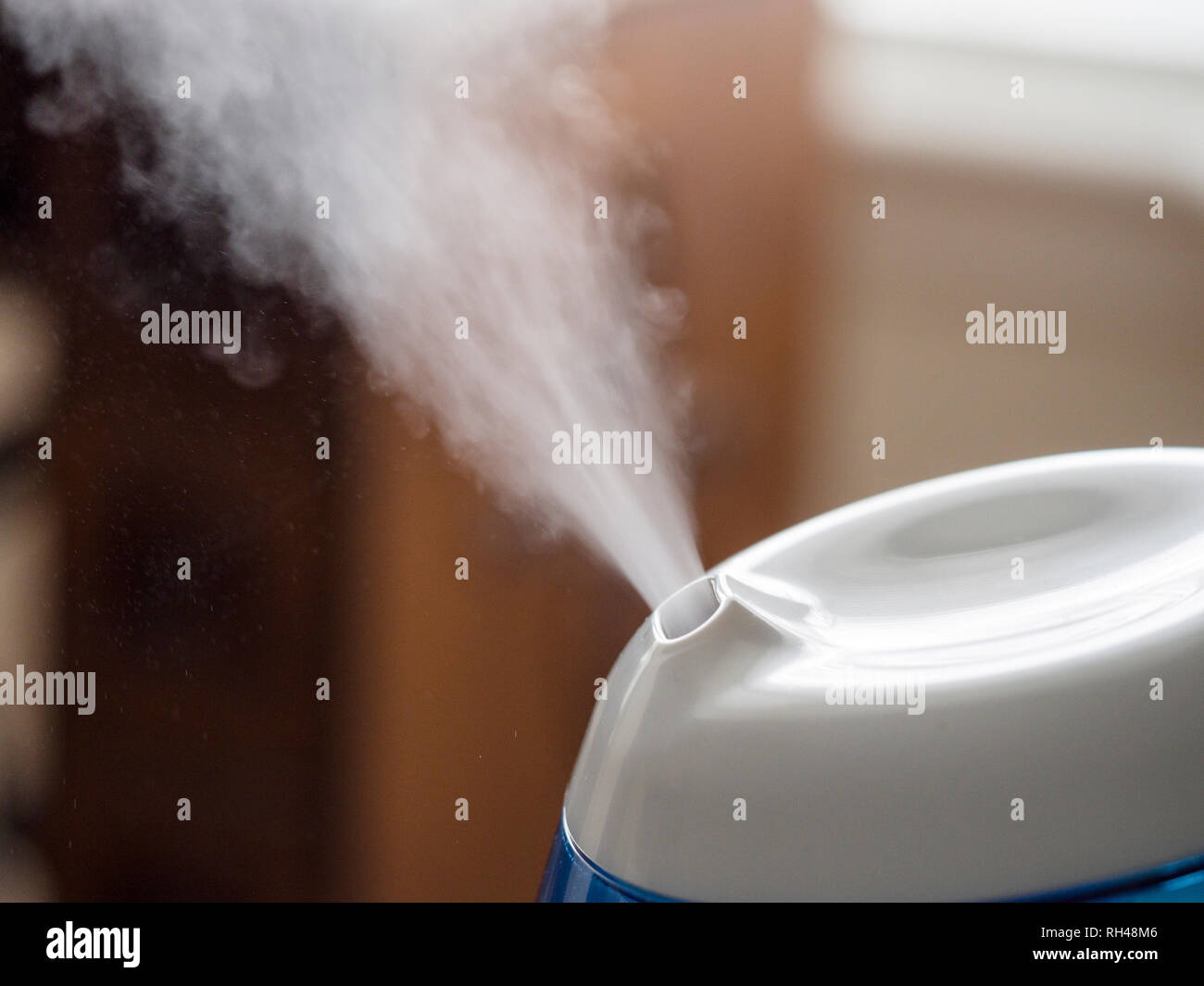 Cold mist humidifier: A nebulizer-based humidifier spews tiny water droplets into the air to rais the humidity on cold winter days. - Stock Image