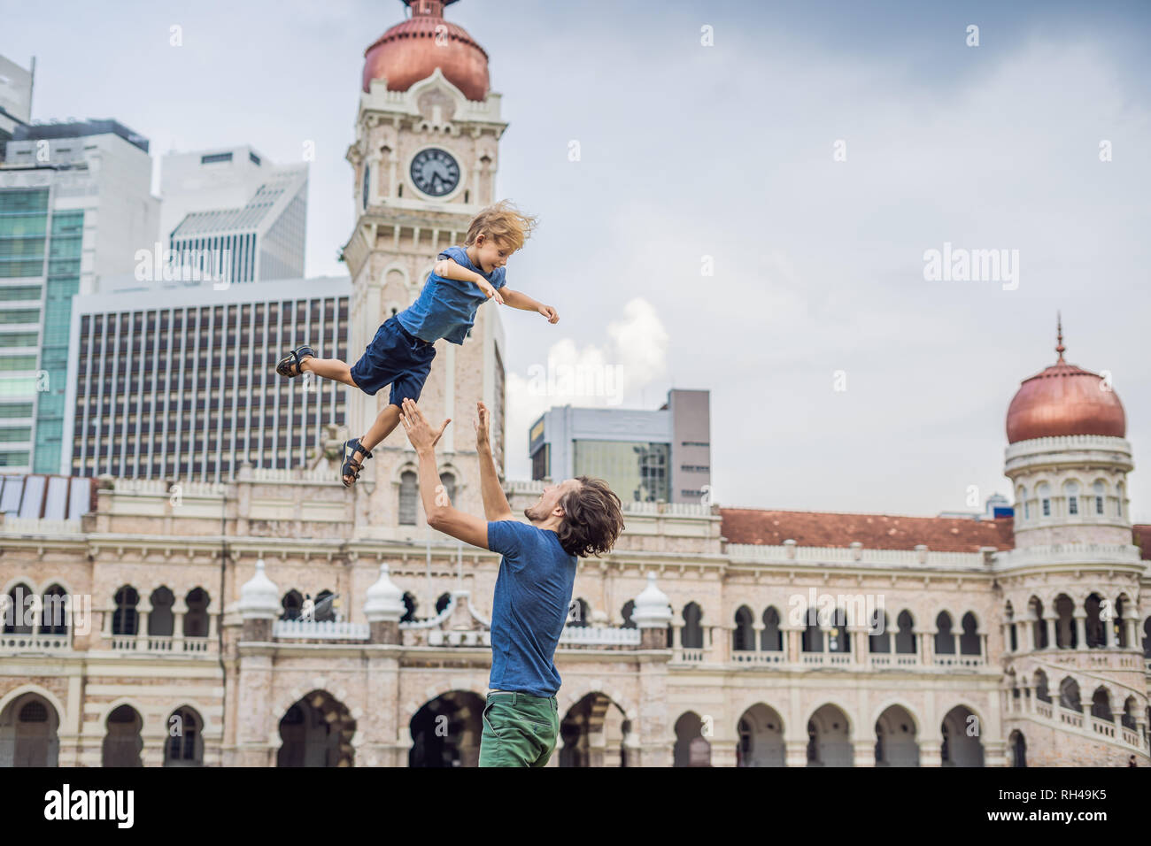 Dad and son on background of Sultan Abdul Samad Building in Kuala Lumpur, Malaysia. Traveling with children concept - Stock Image