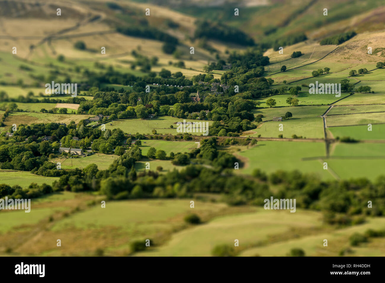 Edale village given the tilt shift look, shot from the summit of Mam Tor in the Peak District National Park. - Stock Image