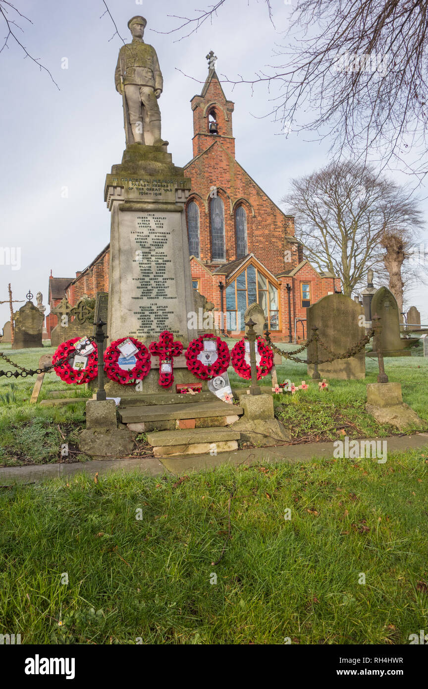 The parish church and cenotaph to the war dead at the church in the village of Wheelock Cheshire England UK - Stock Image