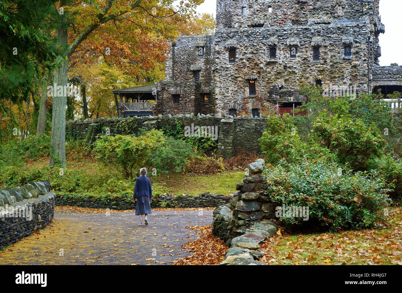 East Haddam, CT USA. Nov 2018. An elderly caretaker walking to work at the Gillette Castle in New England. - Stock Image