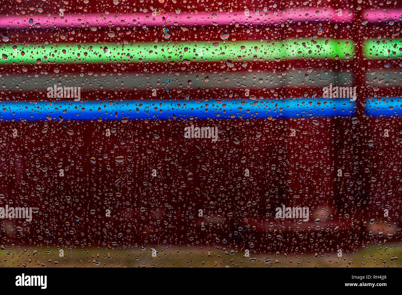 drops reflected in the window with colorful reflections - Stock Image