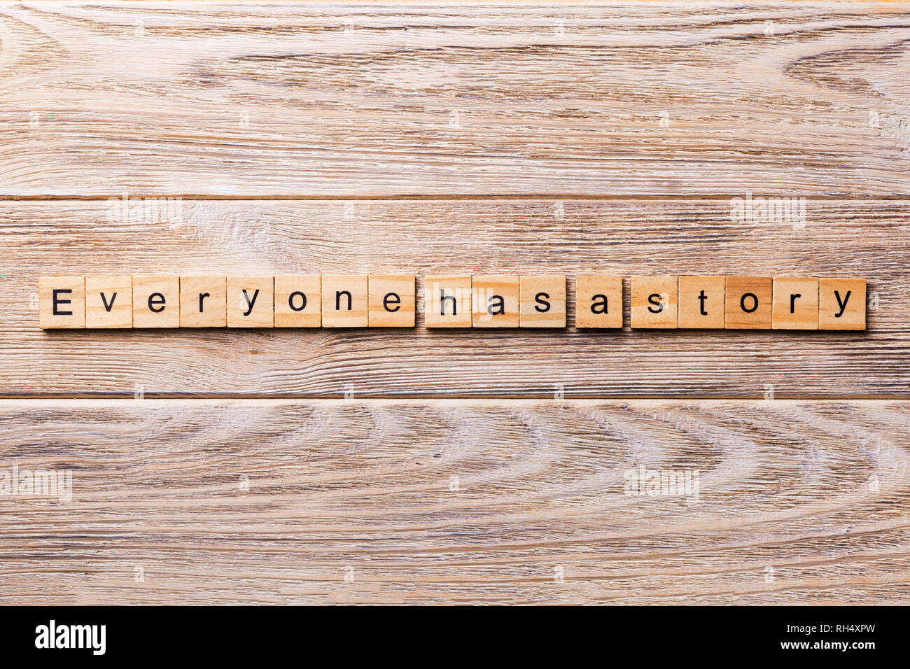 Everyone Has a Story word written on wood block. Everyone Has a Story text on wooden table for your desing, concept. - Stock Image