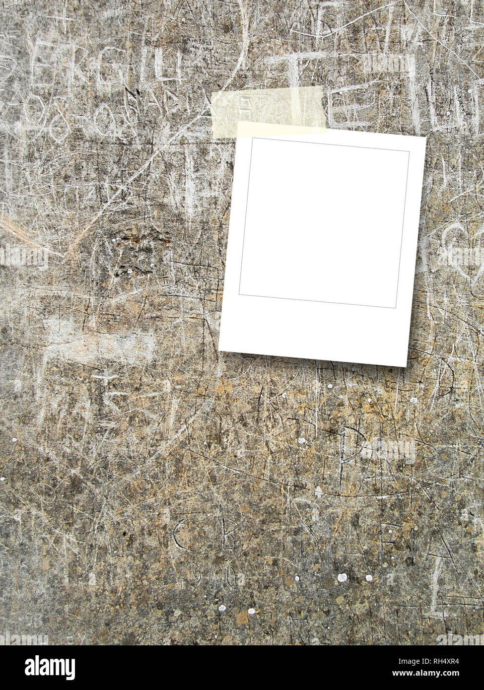 Blank square instant photo frame on concrete wall background - Stock Image