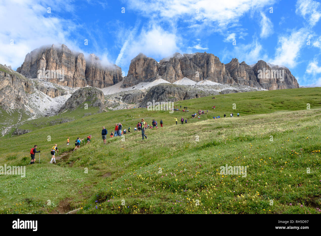 Participants in the Dolomites Skyrace running up the Sella Massif Stock Photo