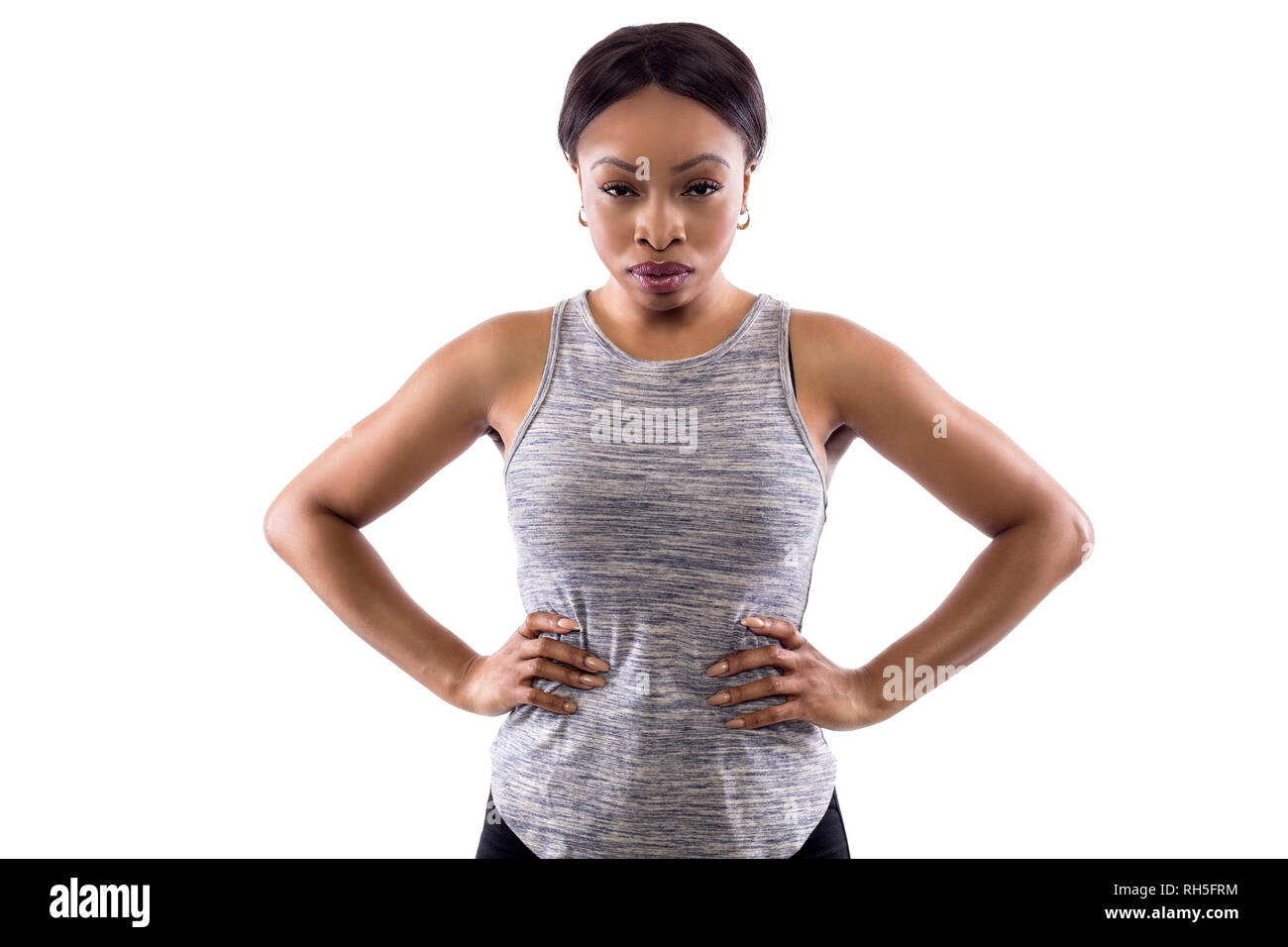 Angry black female wearing athletic outfit on a white background as a fitness trainer - Stock Image