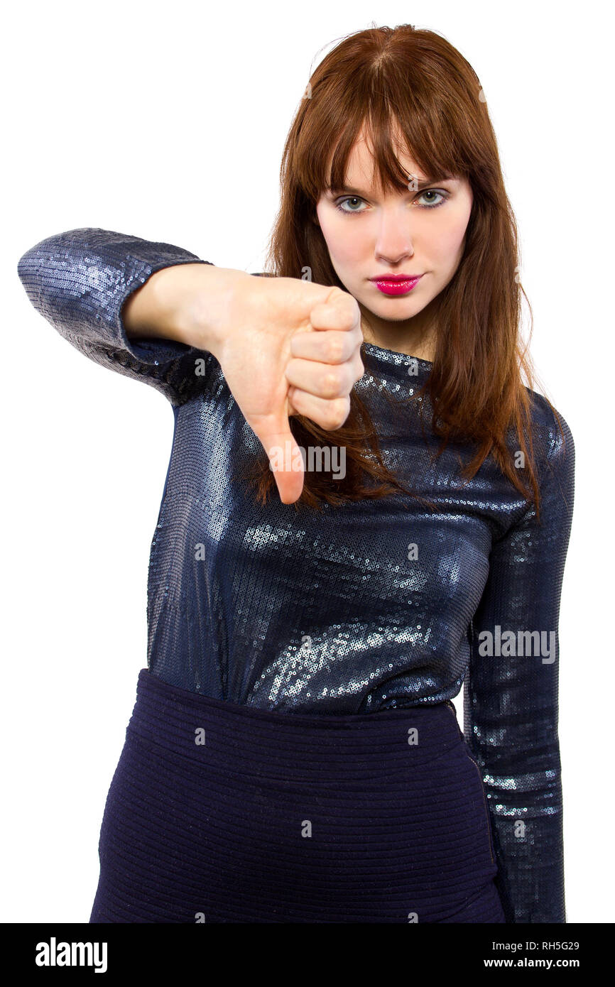 woman is shiny dress downvoting with thumbs down - Stock Image