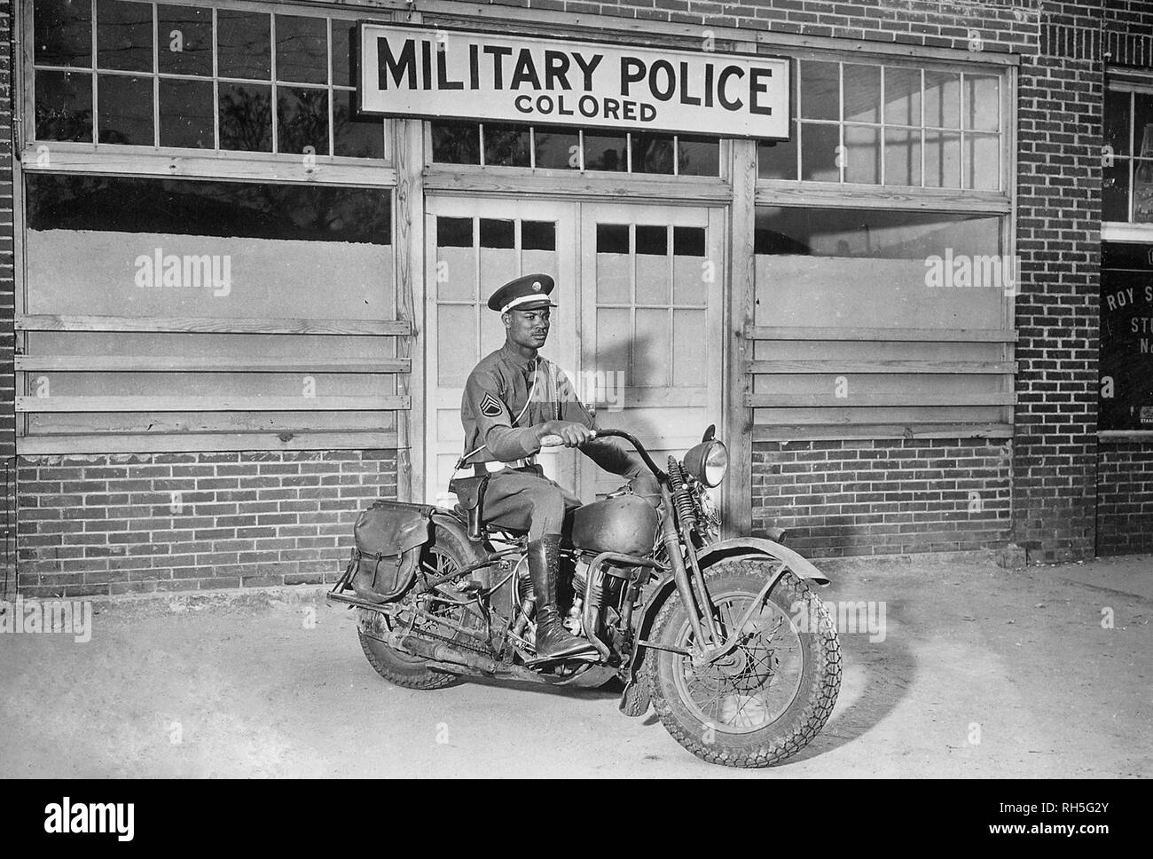 An MP on motorcycle stands ready to answer all calls around his area. Columbus, Georgia. April 13, 1942. - Stock Image