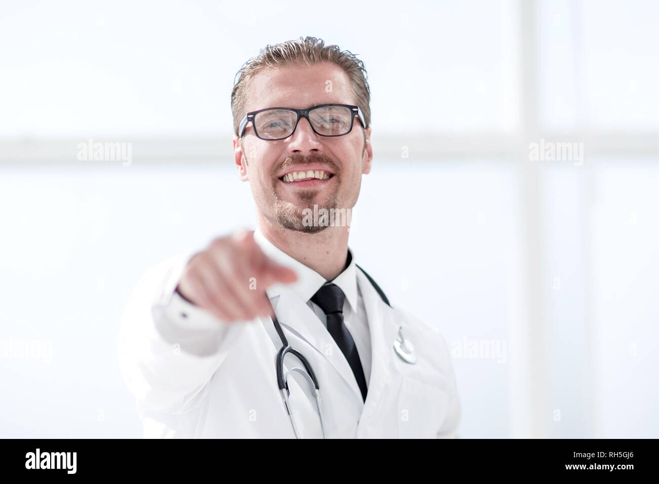 confident doctor therapist pointing finger at you - Stock Image