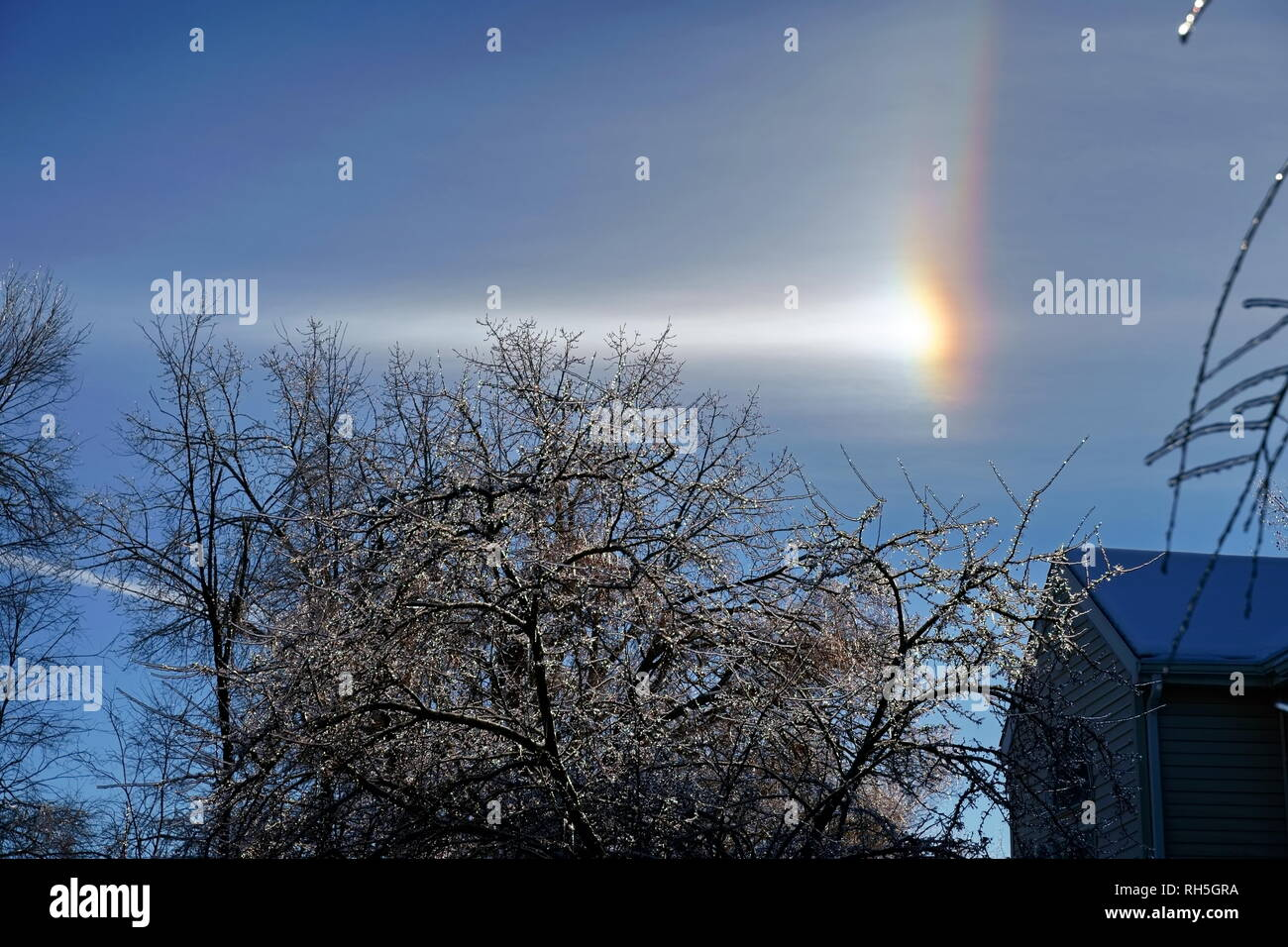 An unusual rainbow phenomena during a New England winter. - Stock Image