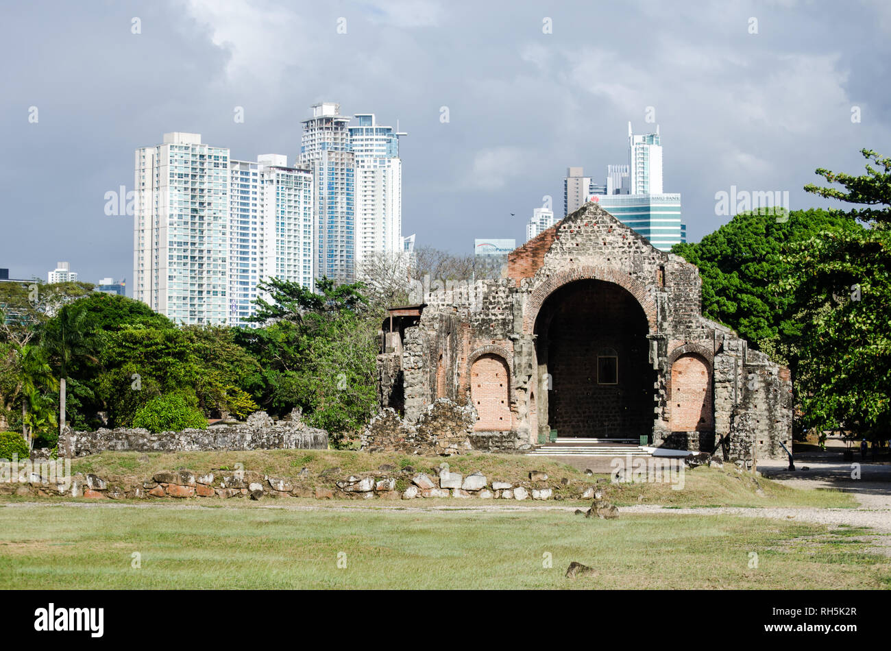 Ruins of Conception Nuns Convent at Panama Viejo. Costa del Este buildings are in the distance - Stock Image