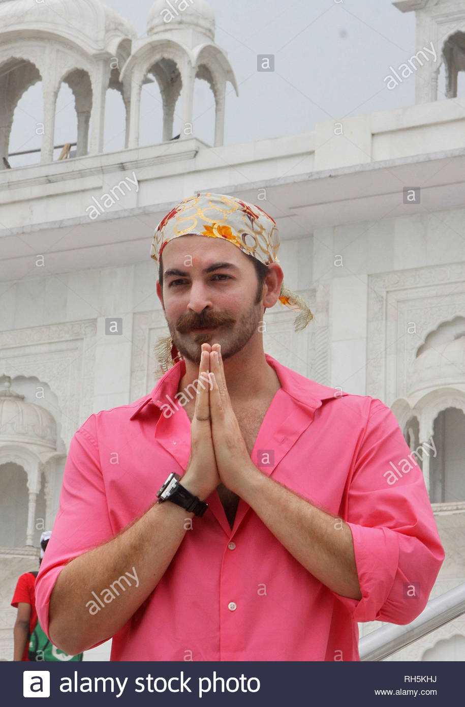 Bollywood actor Neil Nitin Mukesh offers prayer at the Bangla Saheb Gurudwara for the success of his latest movie Shortcut Romeo, in New Delhi, India on June 18, 2013. Shortcut Romeo, scheduled for release on June 21, is a romantic crime thriller produced by Susi Ganeshan which is a Hindi remake of the filmmakerÕs own Tamil film Thiruttu Payale, starring Neil Nitin Mukesh, Puja Gupta and Ameesha Patel. The film was screened at Marche du Film at Cannes Film Festival in May 2013. (Imtiyaz Khan) Stock Photo