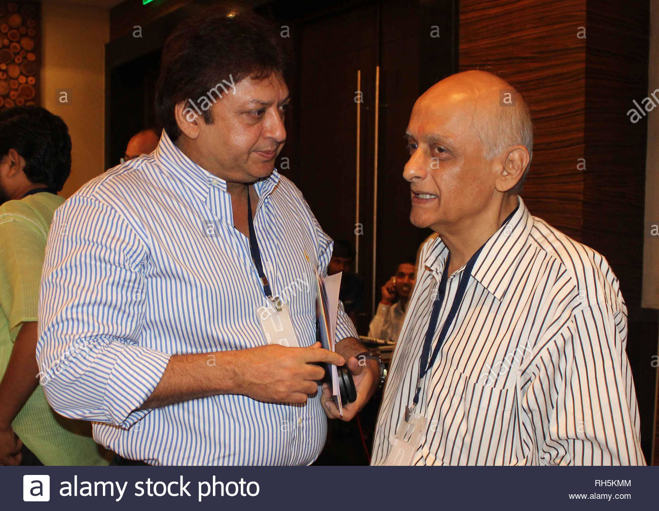 Sashi Ranjan with Bollywood filmmaker Mukesh Bhatt during a panel discussion on 'Building Bridges between creative communities & and priorities of our time' in Mumbai, India on July 18, 2013. (Amol Kamble) - Stock Image