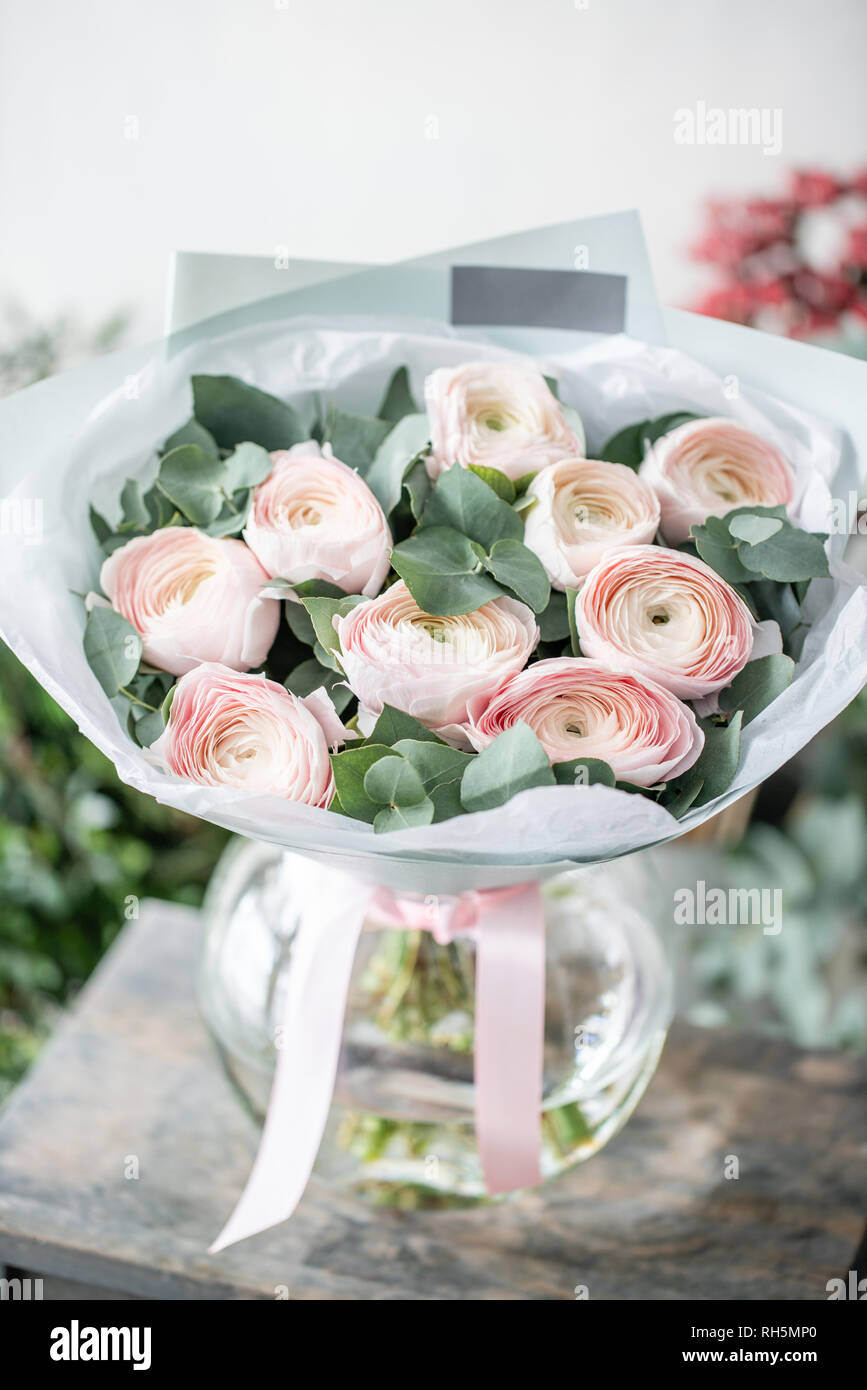 Persian Buttercup In Glass Vases Bunch Pale Pink Ranunculus Flowers With Green Eucalyptus Beautiful Fresh Cut Bouquet In Vase On Wooden Table The Stock Photo Alamy