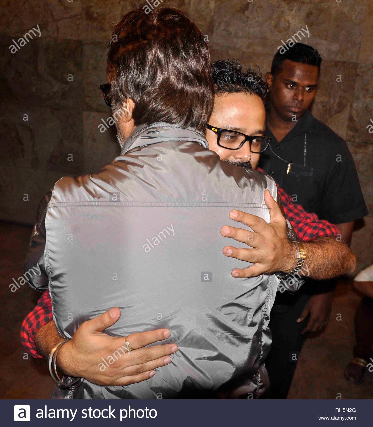 Bollywood actor Amitabh Bachchan hug director Nikhil Advani during