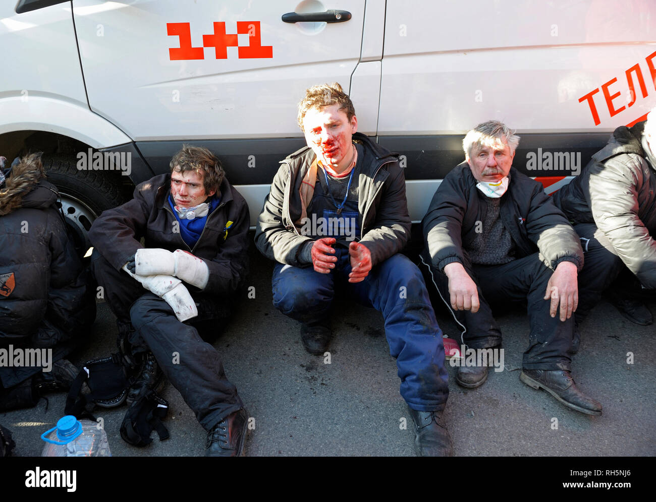 Protesters - victims of police violence on Grushevskogo street, paramedics, an ambulance. Revolution of Dignity.February 18, 2014. Kiev, Ukraine - Stock Image
