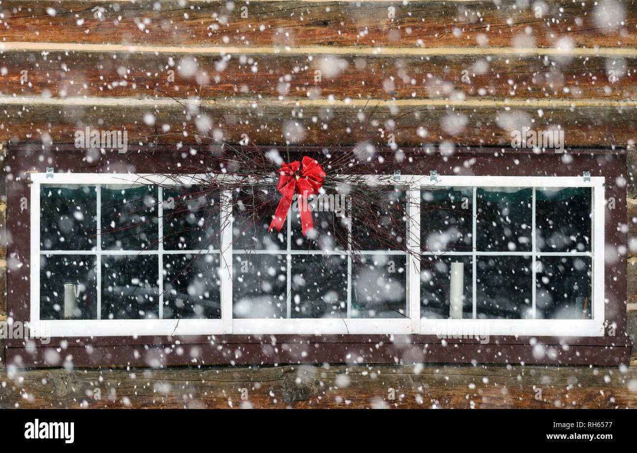 Historic Upper Ford Ranger Station with red ribbon and wreath during the holiday season. Kootenai National Forest, Northwest Montana Stock Photo