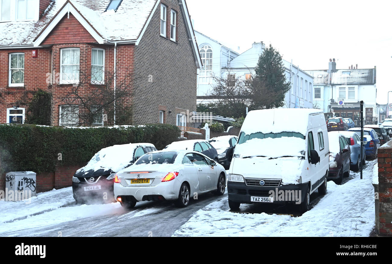 Brighton UK 1st February 2019 - Cars struggle around the side streets of Brighton  after a heavy snowfall overnight . The snow and ice has caused problems with public transport throughout the south and many schools are closed in Britain Credit: Simon Dack/Alamy Live News - Stock Image