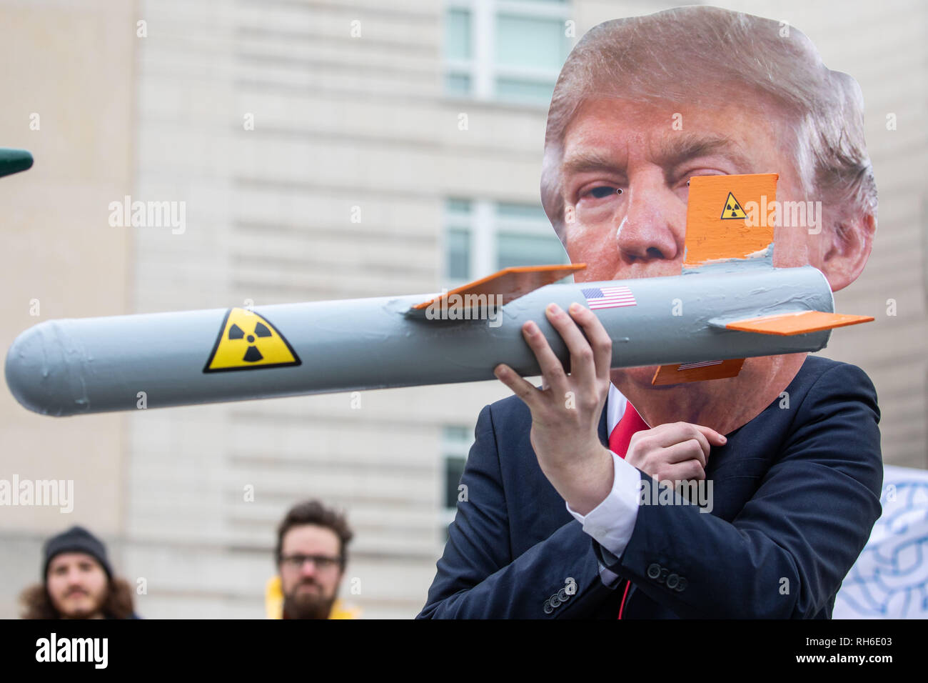 Berlin, Berlin, Germany. 1st Feb, 2019. Activists wear masks to look like U.S president Donald Trump and Russian President Vladimir Putin and hold mockup models of nuclear missiles, during a protest for the INF treaty in front of the American embassy in Berlin, Germany, February 1, 2019. On February 2, 2019, the deadline set by US President Donald Trump Russia for the disarmament of the Iskandar -rocket system ends, The US sees in the system a violation of the INF Treaty, which prohibits the possession of nuclear medium-range systems. For its part, Russia accuses the USA of violating the Credi - Stock Image