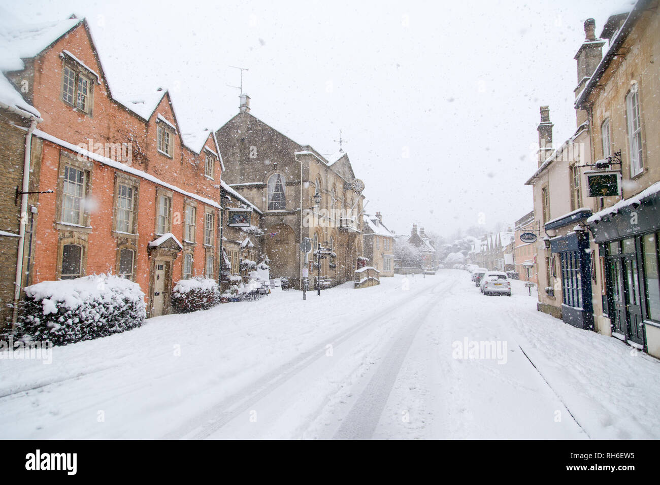 Corsham, Wiltshire, UK. 1st February, 2019. Heavy snowfall blankets the ancient town centre, home to the TV series Poldark and now a wintery scene which was forecast, though arrived late and much heavier than earlier predictions. Local residents brave the cold conditions as heavy snowfall continues to accumulate   throughout the day - with revised forecasts reporting sustained snow until 6pm this evening. The roads   are empty of cars, many schools and business remain closed whilst the wintery weather continues it's icy   grip in Wiltshire. Credit: Wayne Farrell/Alamy Live News Stock Photo
