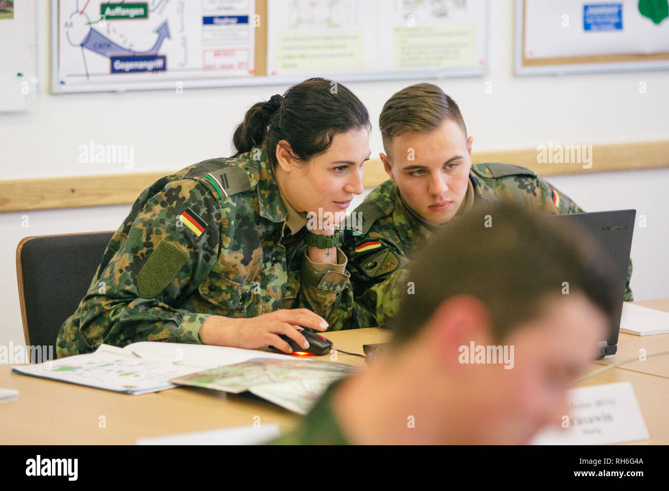 01 February 2019, Saxony, Dresden: During a visit of the Federal Minister for Defence, officer's pupils sit in the classroom of the army's officer's school. Photo: Oliver Killig/dpa-Zentralbild/dpa - Stock Image