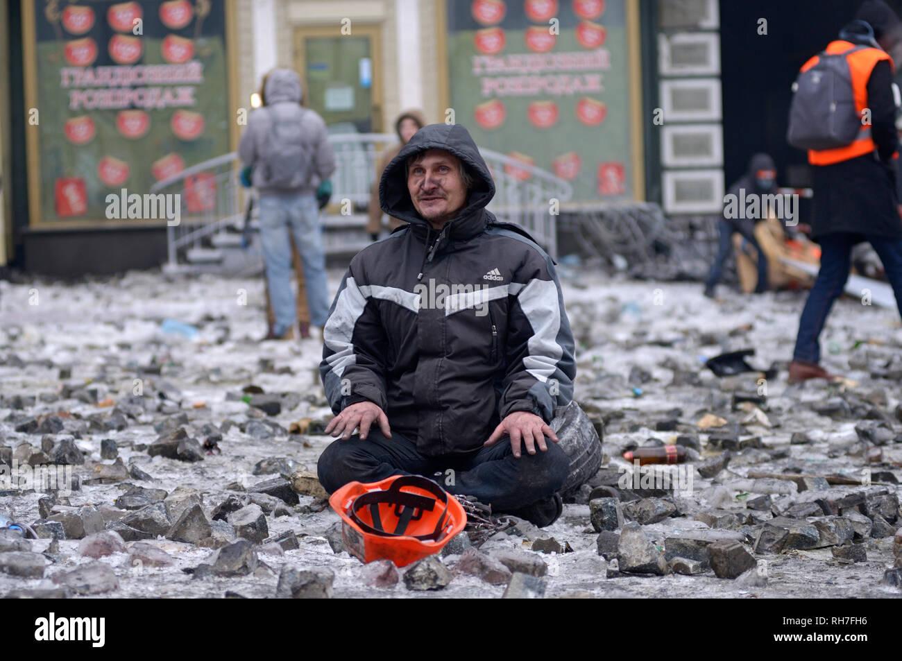 View of Grushevskogo street, protester sitting. Revolution of dignity, street clashes. January 21, 2014. Kiev, Ukraine - Stock Image