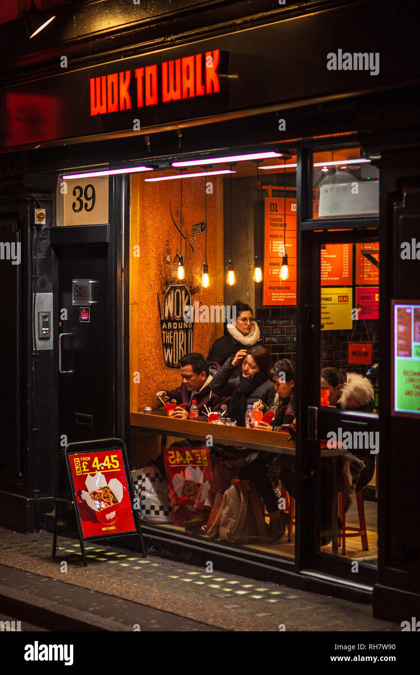 Wok to Walk restaurant in London's West End Entertainment district. Wok to Walk is a NL based chain of Asian fusion wok cooked fast food restaurants Stock Photo