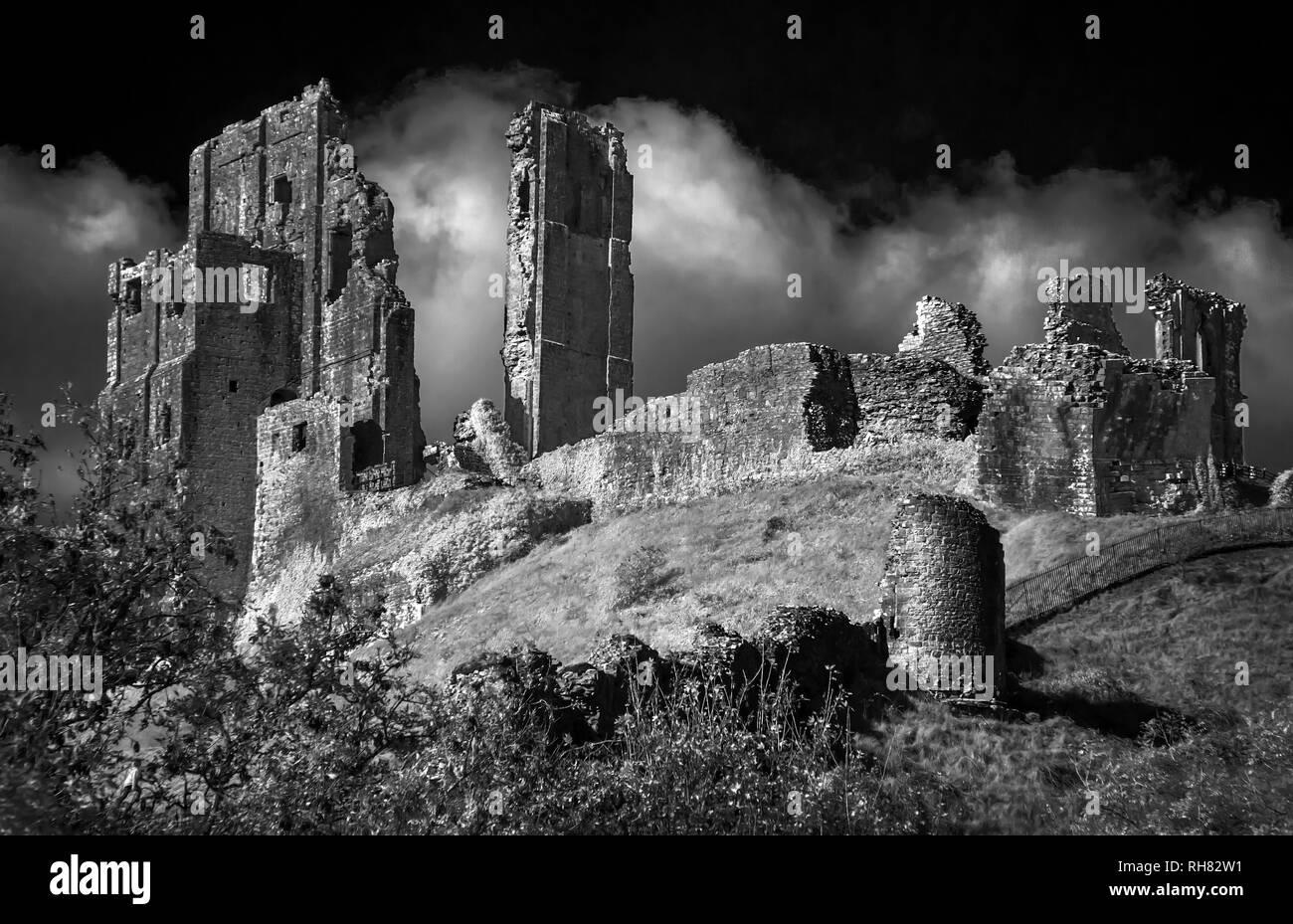 Infrared monochrome image of Corfe Castle in Dorset England - Stock Image