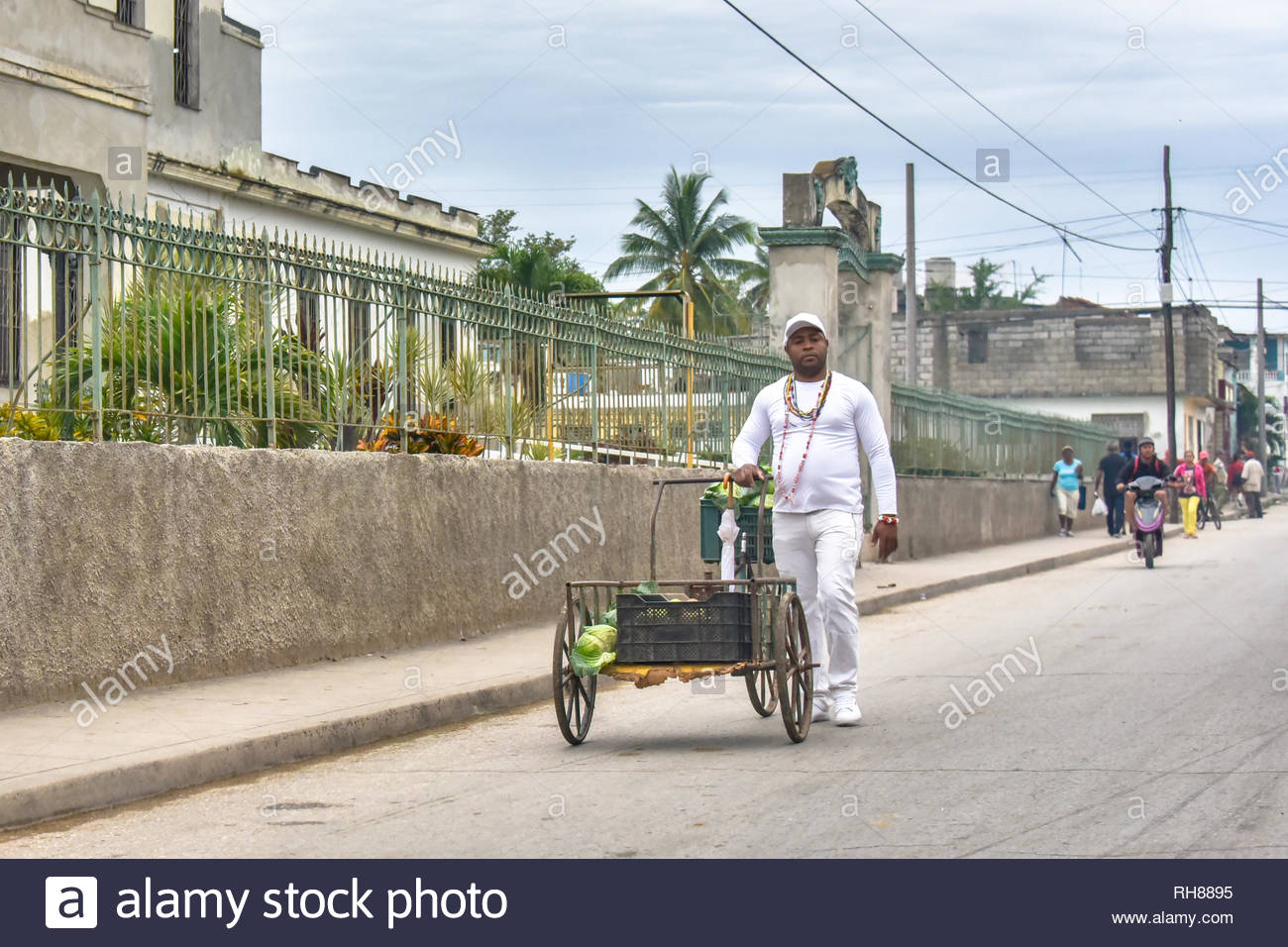 Cienfuegos, Cuba-January 24, 2019:   A 'Saint' candidate according to the religions of African origins. He wears totally white clothes. In his daily r - Stock Image