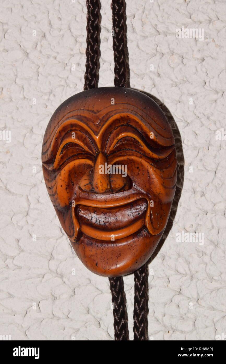 Grimacing Wooden Voodoo Mask - Stock Image