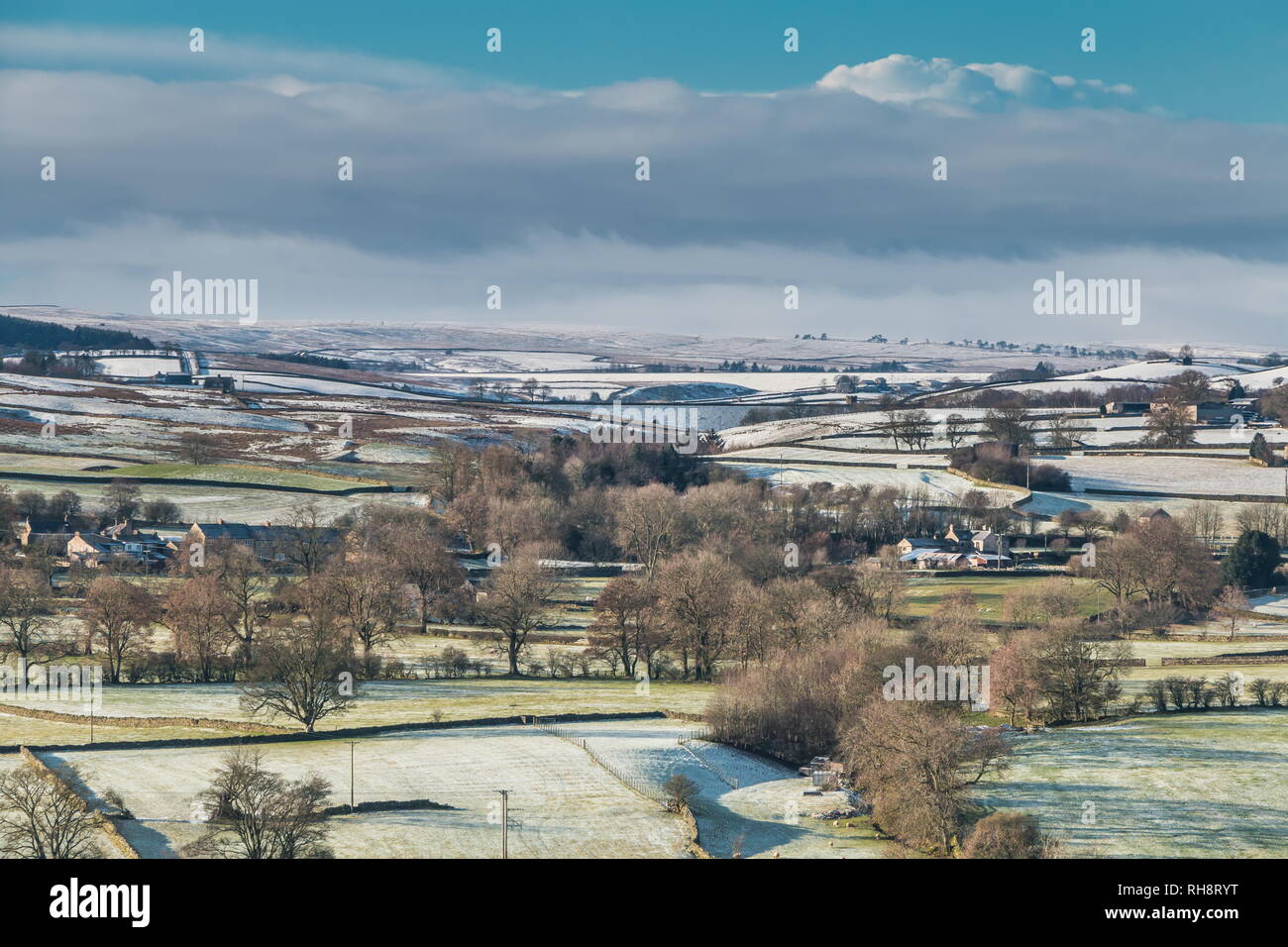 North Pennines AONB landscape, view from Whistle Crag over Teesdale into Lunedale with snow covered hills in the distance in bright winter sunshine Stock Photo