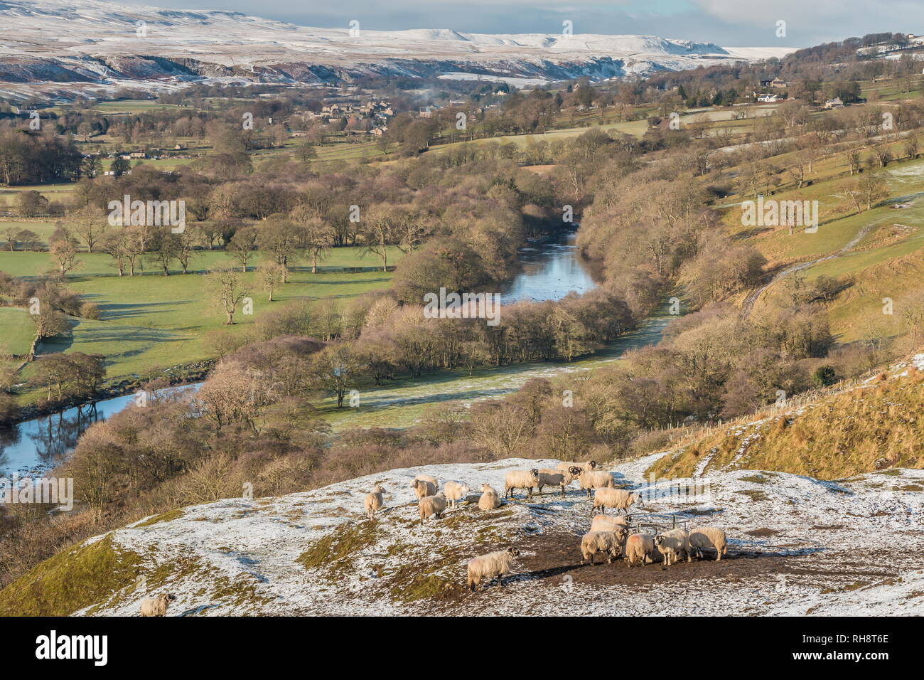 North Pennines AONB landscape, view from Whistle Crag towards Middleton-in-Teesdale and Holwick with snow covered hills in the distance Stock Photo