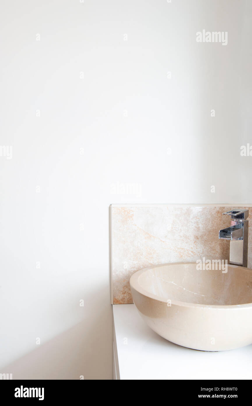 A Granite Wash Basin Sink On A White Bathroom Worktop In Front Of Blank Off White Wall Stock Photo Alamy