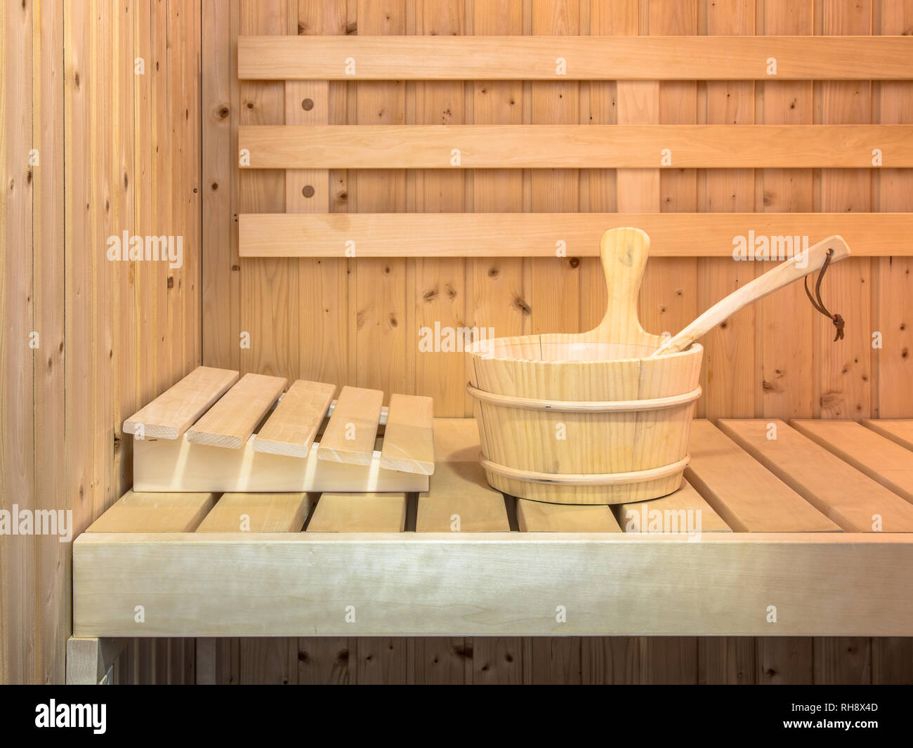 Interior of Finnish sauna with wooden bucket and seats Stock Photo