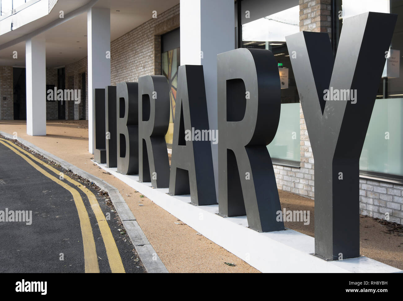 library sign composed of standing capital  letters, outside grove vale library, east dulwich, london, england - Stock Image