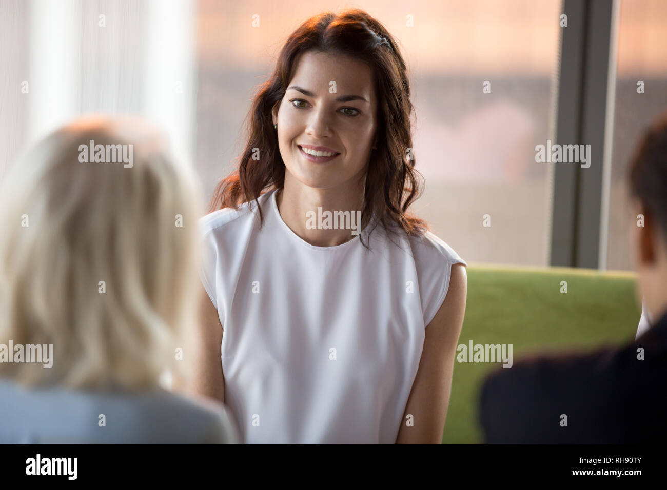 Confident happy applicant smiling looking at hr during job interview Stock Photo