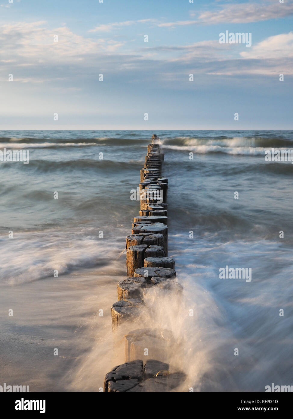 Baltic Sea with breakwaters at daylight Stock Photo