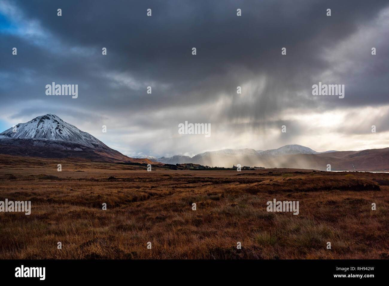Snow clouds over Errigal Mountain at Dunlewey, Donegal, Ireland - Stock Image