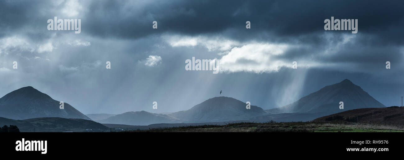 Storm Clouds over Errigal from Magheroarty in Donegal - Stock Image